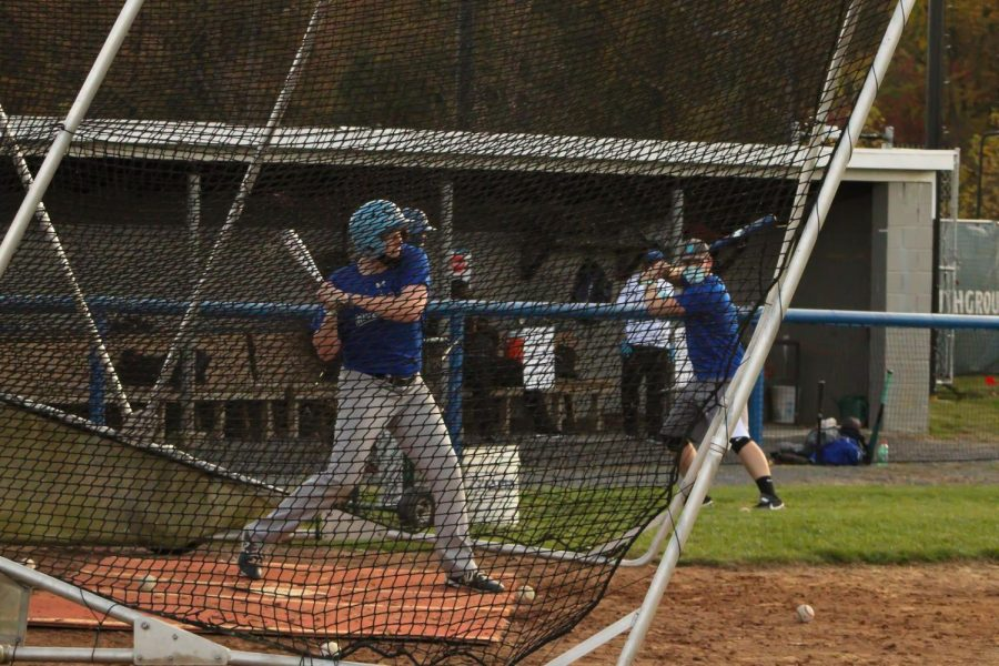 Baseball players practice on campus  this week for the first time since the college closed in March.