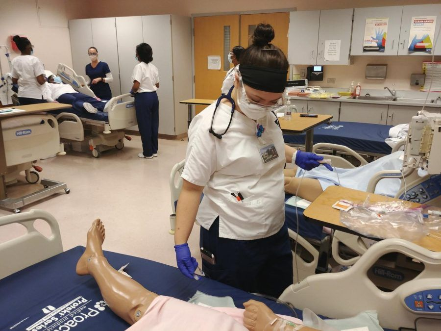 Nursing student Natasha Seeger practices her skills  pre-pandemic in the Florestano building. The nursing program will expand by 54% once it moves into the new Health and Live Sciences building.