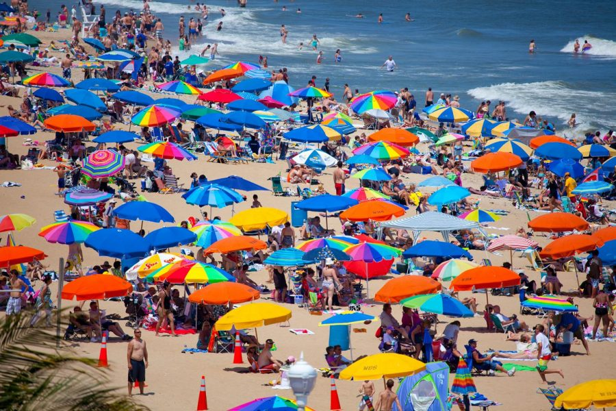 A campus nurse advices students to use high-SPF sunscreen and skip alcoholic drinks while in the sun. Shown, Ocean City, Maryland, pre-pandemic.
