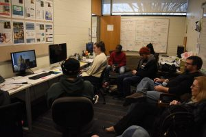 Campus Current staff members sit in their newsroom to watch as the colleges vice presidents explain their plan to shut down the campus in March 2020. The student journalists lost the newsroom, located in the Humanities building, to a ventilation issue this semester.